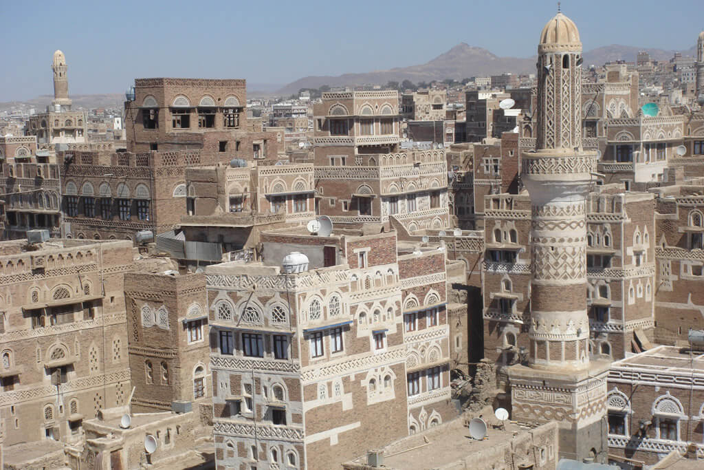 This city in Yemen, Saana, is similar in architecture to the painting, below, of a town in Saudi Arabia.